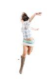 Salto felice della donna Immagine Stock