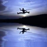 Salto feliz Foto de archivo libre de regalías