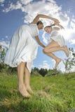Salto feliz da família Imagem de Stock