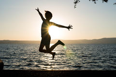Salto feliz da menina Imagem de Stock Royalty Free