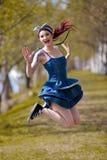 Salto feliz de la chica joven Imagen de archivo libre de regalías
