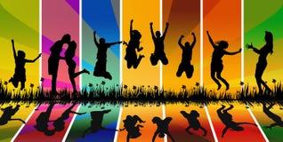 Salto feliz de la gente joven Imagenes de archivo