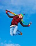 Salto feliz de la muchacha Fotografía de archivo libre de regalías
