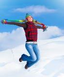 Salto feliz de la muchacha Imagen de archivo libre de regalías