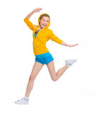 Salto feliz de la muchacha del adolescente Foto de archivo