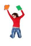Salto feliz de la muchacha del estudiante. Fotografía de archivo libre de regalías