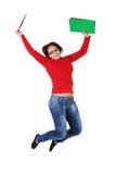 Salto feliz de la muchacha del estudiante. Fotos de archivo