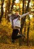 Salto feliz de la mujer Foto de archivo libre de regalías