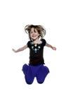Salto feliz de la niña Fotografía de archivo