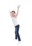 Salto feliz de la niña. Fotografía de archivo