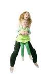 Salto feliz de las hermanas Imagen de archivo