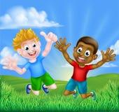 Salto feliz de los muchachos de la historieta Imagen de archivo libre de regalías