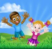 Salto feliz de los niños de la historieta Fotografía de archivo libre de regalías