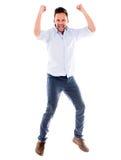 Salto feliz del hombre Imágenes de archivo libres de regalías