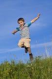 Salto feliz del muchacho Fotos de archivo libres de regalías