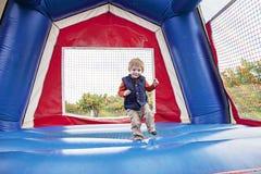 Salto feliz del muchacho Imagen de archivo libre de regalías