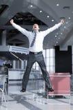 Salto feliz do homem de negócio foto de stock royalty free