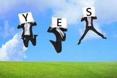 Salto feliz do homem de negócio com texto do yes fotos de stock royalty free