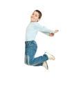 Salto feliz do miúdo Foto de Stock