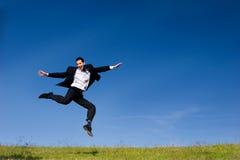 Salto feliz do negócio Fotografia de Stock Royalty Free