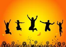 Salto feliz dos povos Fotos de Stock