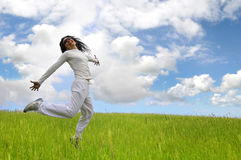 Salto feliz grande foto de archivo libre de regalías