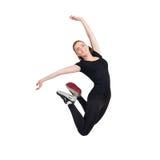 Salto feliz joven de la mujer aislado en el blanco Foto de archivo