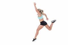Salto femenino del atleta Fotografía de archivo libre de regalías