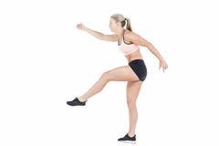 Salto femenino del atleta Fotos de archivo
