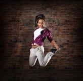 Salto femenino joven del bailarín Foto de archivo
