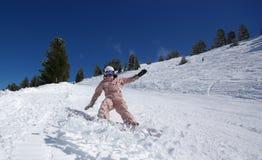Salto hermoso del snowboarder Imagenes de archivo