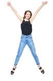 Salto joven feliz de la muchacha del adolescente aislado Imágenes de archivo libres de regalías