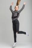 Salto lindo de la muchacha Fotografía de archivo