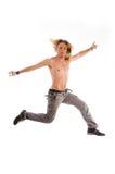 Salto masculino descamisado en aire Foto de archivo libre de regalías