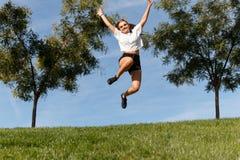 Salto para la alegría foto de archivo libre de regalías