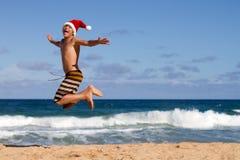 Salto para la alegría de la Navidad Imagen de archivo libre de regalías