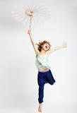 Salto rubio de la muchacha Foto de archivo libre de regalías