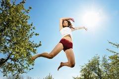 Salto sexy del danzatore Immagine Stock