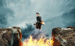 Salto sobre la llama del hueco imágenes de archivo libres de regalías