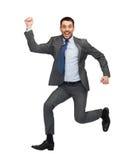 Salto sonriente del hombre de negocios Fotos de archivo