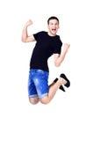 Salto sonriente joven del hombre Foto de archivo libre de regalías