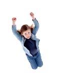 Salto sonriente lindo de la muchacha Imagen de archivo libre de regalías