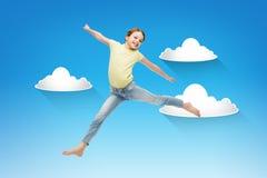 Salto sorridente della bambina Immagini Stock