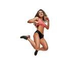Salto sportivo della donna Fotografie Stock Libere da Diritti