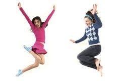 Salto teenager insieme Fotografia Stock