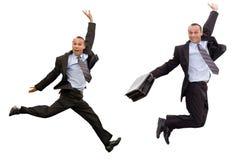 Salto victorioso del hombre de negocios Foto de archivo libre de regalías