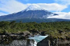 Saltos de Petrohue Falls in Patagonia Chile. The beautiful and photogenic Saltos de Petrohue falls, a small waterfall with the Osorno Volcano in the background stock photos