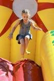 Saltos em atrações infláveis Imagens de Stock Royalty Free