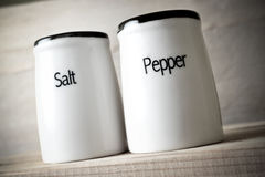 Saltshaker and pepper pot closeup. Toned photo of saltshaker and pepper pot, taken from below royalty free stock photography