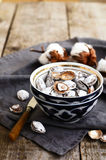 Salty apricot pits in oriental ceramic pattern bowl Stock Photos